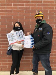 Jennifer Chen delivers community resources  and mask to workers in Winnipeg.
